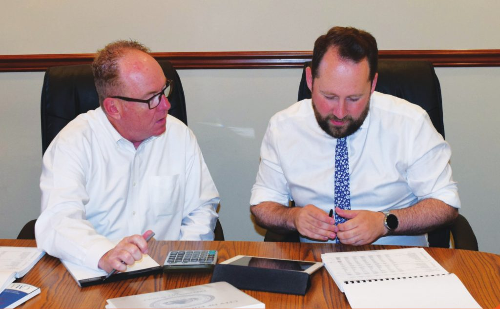 Mike Young and Rob Rolison are working to fix our City's finances together.
